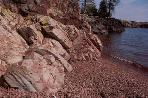 This pink rhyolite beach at Fish Cove, with its variety of geology and plant life, is one of the Keweenaw Tip sites photographer Charlie Eshbach showed Natural Resources Trust Fund Board members during their September 12, 2001, meeting in Lansing. (Photo courtesy Charlie Eshbach)